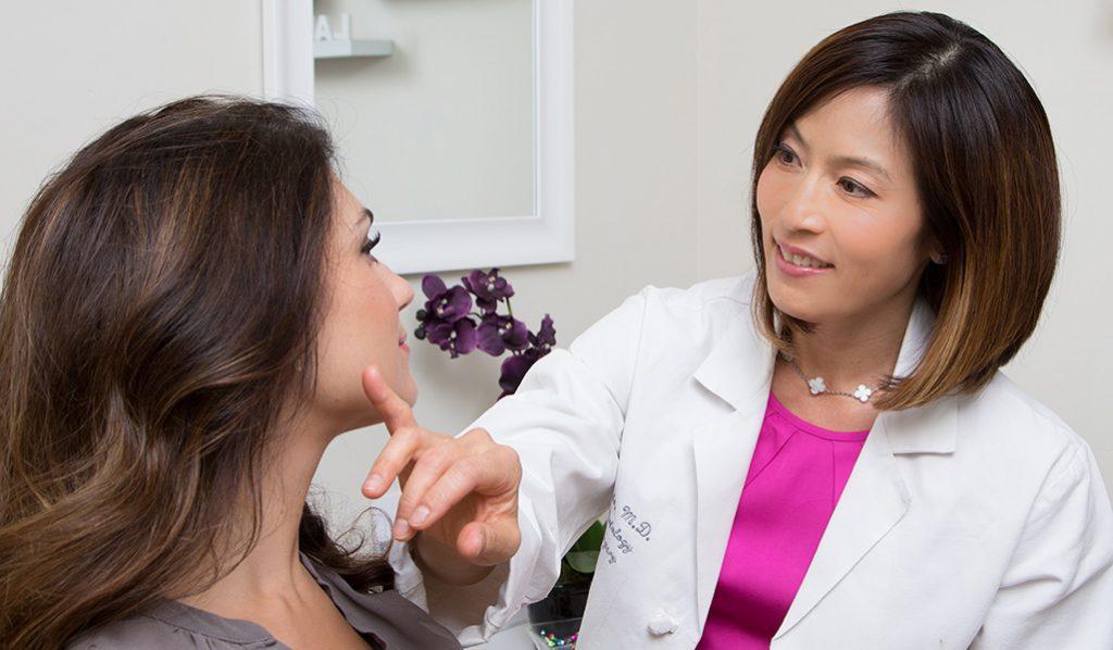 Dr. Kato with a patient